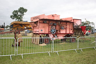 Marshall, Sons & Co. - A Marshall Threshing machine being demonstrated at the Holcot Steam Rally 2008 in Northamptonshire, with a Massey-Harris baler attached (rhs)