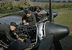 Mechanics at work on the Merlin engines of a Handley Page Halifax Mk II of No. 35 Squadron at Linton-on-Ouse, June 1942. TR19.jpg