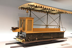 "Daimler Company - Gottlieb Daimler's railcars ""tirelessly ferrying passengers around the Bremen showground as if by magic""."