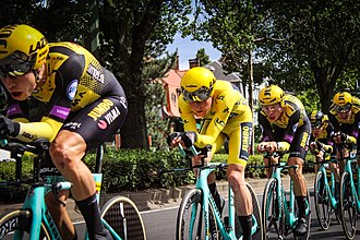 Team Jumbo-Visma's Mike Teunissen (centre) during stage two's team time trial, wearing the general classification leader's yellow jersey following his unexpected victory of the opening stage Mike Teunissen en jaune.jpg