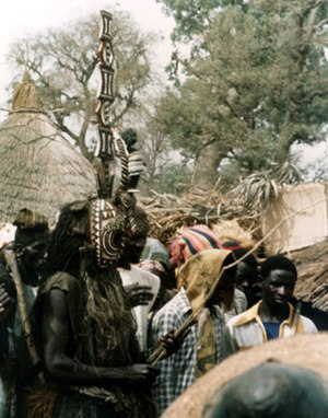 Art of Burkina Faso - A mask at a funeral in the village of Kirsi in 1976.  A black plastic child's doll has been added to the horns to create a karan wemba, to honor a female ancestor.