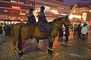 Mounted police patrol an urban center in Finland by horseback.