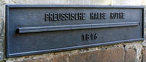 """Obsolete German units of measurement - A standard at the City Hall in Münster, Germany from 1816; the bar shown is one """"Prussian half rod"""" long."""