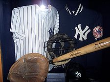 Thurman Munson's mask and mitt on display in Cooperstown .They previously hung in his unused locker as a memorial.