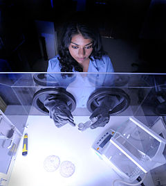 NASA Goddard technologist studies a paint sample in her laboratory.jpg