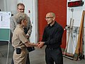 NAVFAC EXWC Personnel Receive Command Coins (17372588485).jpg