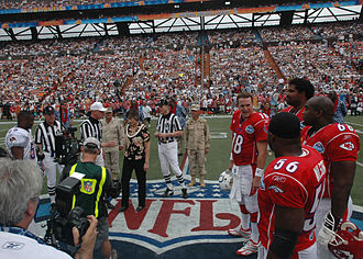 2006 Pro Bowl - The coin toss before the game with Derrick Brooks (left) representing the NFC and Peyton Manning, Al Wilson, Jonathan Ogden and Will Shields representing the AFC