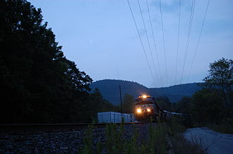 Pan Am Southern - Westbound train on Pan Am Southern in Zoar, Massachusetts led by Norfolk Southern ES40DC 7613