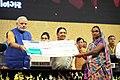 Narendra Modi handing over cheque to beneficiaries of Swavlamban Abhiyaan - new pro-poor initiatives of the Gujarat Government, at the Mahatma Mandir, in Gandhinagar, Gujarat. The Chief Minister of Gujarat.jpg