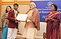 Narendra Modi presenting the National Bravery Awards 2015 to the children, in New Delhi on January 24, 2016. The Union Minister for Women and Child Development, Smt. Maneka Sanjay Gandhi is also seen (7).jpg