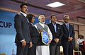 Narendra Modi with the Minister of State for Youth Affairs and Sports (IC) and Information & Broadcasting, Col. Rajyavardhan Singh Rathore and other dignitaries at the 2017 FIFA U-17 World Cup match, in New Delhi.jpg