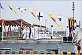 National Flag and Naval Ensign being hoisted for the first time during the Commissioning Ceremony commissioning ceremony of INS Kiltan.jpg