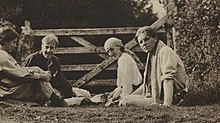 Group of neopagans, Noel Olivier; Maitland Radford; Virginia Woolf; Rupert Brooke, sitting in front of a farm gate on Dartmoor in August 1911