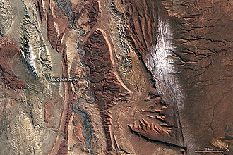 Neuquén River - Neuquén River and geologic basin, showing the deep reds of the Candeleros Formation sandstones. NASA satellite image, 2018