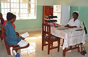 Traditional African medicine - Nurse at Koidu Hospital in Sierra Leone consulting with patients.