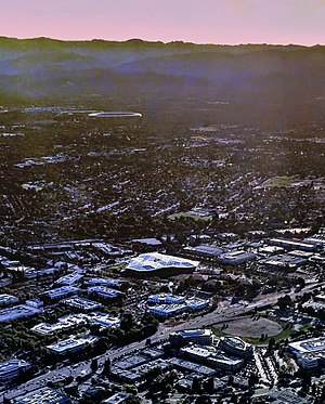 Nvidia - Aerial view of the new Nvidia headquarters building and surrounding campus and area in Santa Clara, California, in 2017.  Apple Park is visible in the distance.