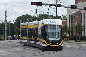 Dallas Streetcar - A streetcar turning from Zang Blvd. onto Colorado Blvd., outbound on the 2015-opened section of the line