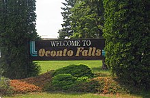 Oconto Falls greeting sign, Summer 2013.jpg