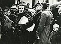 Old woman in the queue to get food in Kiruna, Norwegian refugees in 1944.jpg