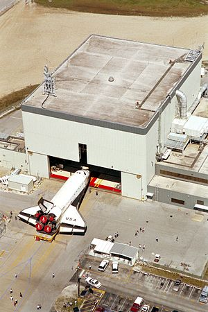 Orbiter Processing Facility - Space Shuttle ''Columbia'' at the entrance of an Orbiter Processing Facility
