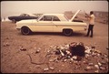 PARKED CARS AND LITTER ON THE BEACH - NARA - 543163.tif