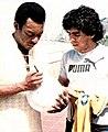 Pele signing ball maradona.jpg