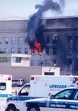 American Airlines Flight 77 - A fire at the Pentagon, with police and EMS in the foreground