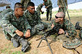 Philippine Marine Cpl. Milky Espere, left, and Cpl. Raymond Almonte, center, listen to U.S. Marine Corps Lance Cpl. Adrian Sandoval as he demonstrates how to disassemble a M240 machine gun 130405-F-HL283-112.jpg