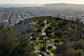Philopappos Hill and in the background the Saronic Gulf and the peninsula of Piraeus.jpg