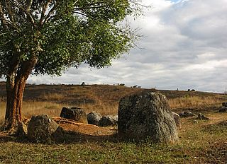 Plain of Jars megalithic archaeological landscape in Laos, consisting of thousands of stone jars scattered around the upland valleys and the lower foothills of the central plain of the Xiangkhoang Plateau