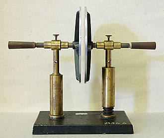 Capacitor - A simple demonstration capacitor made of two parallel metal plates, using an air gap as the dielectric.