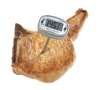 Meat thermometer - A digital food thermometer in pork
