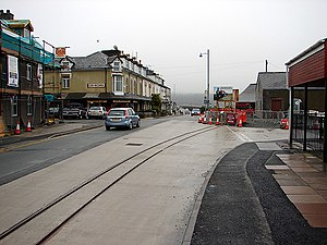 Porthmadog cross town link - The tramlines laid across the main road through Porthmadog towards the Ffestiniog Railway's Harbour station