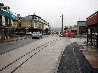 Porthmadog cross town link - The tramlines laid across the main road through Porthmadog towards the Ffestiniog Railway's Harbour station