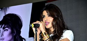 Priyanka Chopra singing on stage