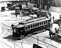 Puget Sound Traction, Light & Power Company car turning the corner at 4th Ave and Jackson St next to Union Station, 1913 (SEATTLE 695).jpg