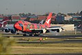 "Qantas Boeing 747-400 ""Wunala Dreaming"" touching down on RWY 16R at Sydney Airport.jpg"