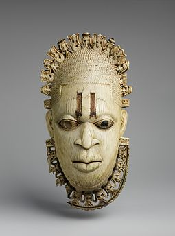 Royal Benin ivory mask, one of Nigeria's most recognized artifacts. Benin Empire, 16th century. Queen Mother Pendant Mask- Iyoba MET DP231460.jpg