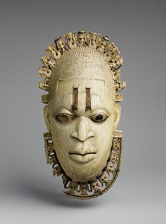 Royal Benin ivory mask, one of Nigeria's most recognised artefacts. Benin Empire, 16th century. Queen Mother Pendant Mask- Iyoba MET DP231460.jpg