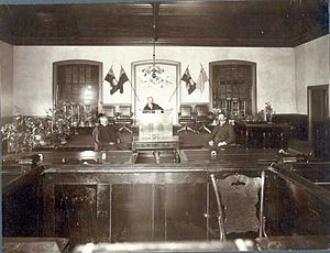 Court of Queen's Bench for Saskatchewan - Regina Court House 1900, Victoria Avenue and Hamilton Street . Pictured are Dixie Watson (seated right), Court Clerk; J.M. Duncan; Justice Newlands.