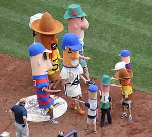 Sausage Race - The regular sausages tag the Little Weenies. They finish Sunday afternoon races for their Racing Sausage counterparts.