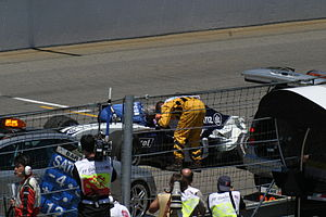 2004 United States Grand Prix - Ralf Schumacher is attended to by Professor Sid Watkins after impacting the wall out the outside of turn thirteen on lap ten.