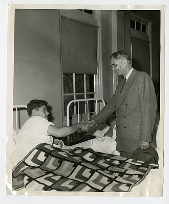 Ralph Austin Bard - Ralph Austin Bard visits a wounded U.S. Marine in San Diego in 1944.