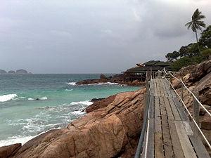Redang Island - A rocky beach and a wooden bridge near Laguna Redang Resort in Pulau Redang.