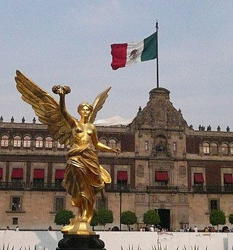 Architecture of Mexico - A replica of El Ángel in front of the National Palace in Mexico City.