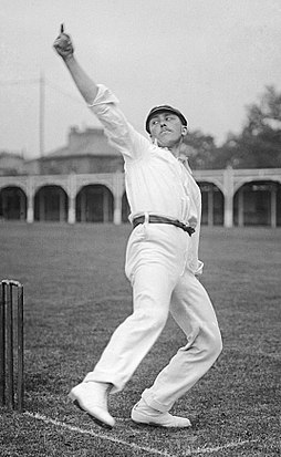 A cricketer bowling, seen from the front