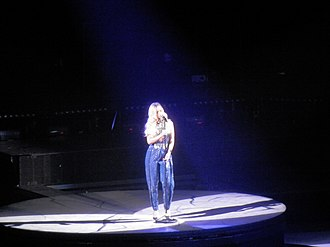 """Diamonds World Tour - Rihanna performing """"Stay"""" during a concert of the tour. The performance of the song together with other ballads was praised by critics."""