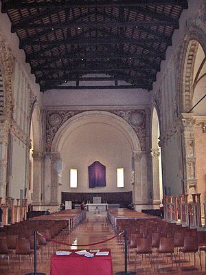 Tempio Malatestiano - The cathedral's nave, with crucifix in the apse veiled for Passiontide.