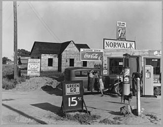 Riverbank, California - Store and gas station in Riverbank, 1940. Photo by Dorothea Lange.