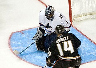 Roberto Luongo - Luongo with Chris Kunitz at the lip of his crease in 2006